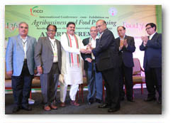Also seen in the photo (Left to Right): Mr. Shivkumar - FICCI, Mr. J. A. Choudary - FICCI, Mr. Nadendla Manohar - Hon'ble Speaker, Legislative Assembly, Government of Andhra Pradesh, Mr. I. Y. R. Krishna Rao (I A S, Special Chief Secretary - Agri Marketing, Go AP), Mr. Kali prasad, and Mr. Kapil Mohan